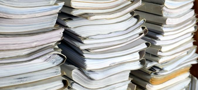 Large Stacks of Papers to be Purge Shredded