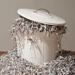 paper shredding in a bin