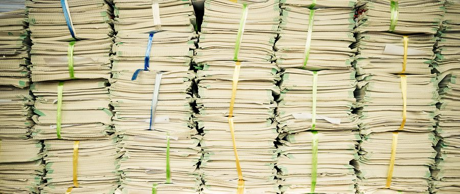 Stacks of paperwork from a keep all policy